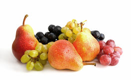 Fruits. Black, green, rose grape and red pears Royalty Free Stock Photography