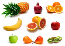 Fruits. A lot of delicious fresh fruits on white background Stock Image