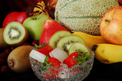 Fruits. Fresh fruits on the black background Stock Photos