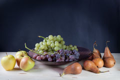 Fruits. Still life with apples, grapes and pears Stock Photography
