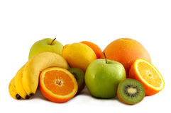 Fruits. A lot of fresh fruits isolated on white Stock Photos