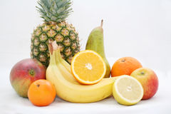 Fruits. Still life of pineapple, oranges, bananas, and other fruits royalty free stock photo