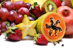 Fruits. Variety of fresh colorful fruits on white background stock photo