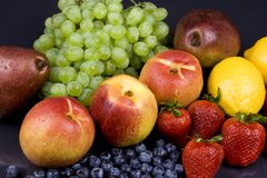 Fruits. Assorted fruits on a black background Royalty Free Stock Photography