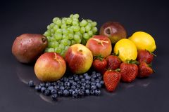 Fruits. Assorted fruits on a black background Royalty Free Stock Photos