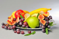 Fruits. Colorful fresh fruits on crystal dish, isolated on white background Stock Photos