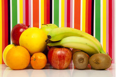 Fruits. Apple, pear, orange, grapefruit, mandarin, kiwi, banana. Multi-color background Royalty Free Stock Image