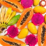 Fruits background of banana, papaya, mango and dragon fruits. Flat lay. Top view. Tropical fruit concept. Fruits background of banana, papaya, mango and dragon stock photography