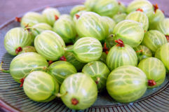 Fruits background with gooseberries Stock Images