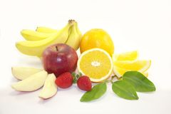 Fruits - bananas, oranges, apples, strawberries Stock Photography
