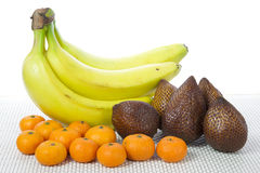 Fruits Bananas Salak and Clementines with white background. Picture of Fruits Bananas Salak and Clementines with white background Stock Images
