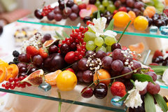 Fruits on banquet table Stock Photos