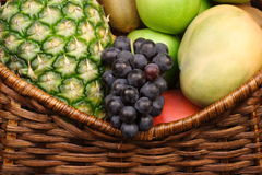 Fruits on basket Stock Photos