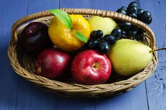 Fruits in basket Stock Photo