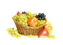 Fruits in basket. Isolated on white background Stock Photography