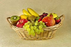 Fruits in basket. Apple, grapes, kiwi, banana, strawberry in basket Royalty Free Stock Images