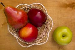 Fruits in a basket Stock Photos