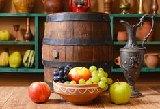 Fruits in a basket with a barrel Stock Photo