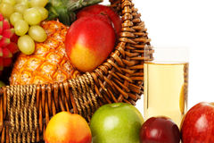 Fruits in basket and juice. Stock Photos