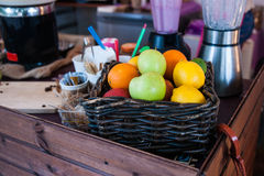 Fruits in a basket on a snack bar table Royalty Free Stock Images