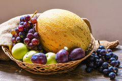 Fruits in basket. On table, still life Stock Photo