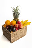 Fruits in Basket on White Background Royalty Free Stock Photo