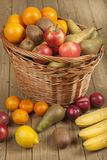 Fruits and basket on wooden surface Royalty Free Stock Photos