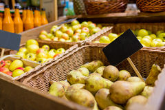 Fruits in baskets with nameplates at food market Stock Images