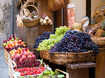 Fruits beeing offered. A market stand offering fresh fruits in sienna, italy Stock Photos