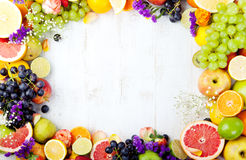 Fruits, berries , flowers frame, white wooden background. Copy space. Royalty Free Stock Photo