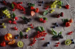 fruits and berries on an ice cream background stock photo