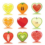 Fruits and berries icons set.White background. Fruits and berries icons set.Cut of differend  fruits and berries in the shape of a heart with reflection Stock Photography