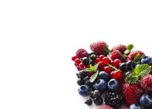 Fruits and berries isolated on white background. Ripe currants, raspberries, blueberries,  strawberries and blackberries with a mi. Nt leaf. Sweet and juicy Stock Photos