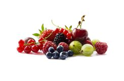 Fruits and berries isolated on white background. Ripe currants, raspberries, cherries, strawberries, gooseberries, mulberries and. Bilberries. Background of mix royalty free stock image