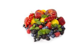 Fruits and berries isolated on white background. Ripe currants, strawberries, blackberries, bluberries, peaches and yellow plums. Sweet and juicy fruits at stock photography