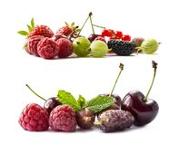Fruits and berries isolated on white background. Ripe raspberries, cherries, strawberries, gooseberries, red currants, and mulberr. Ies. Background of mix fruits Royalty Free Stock Photography