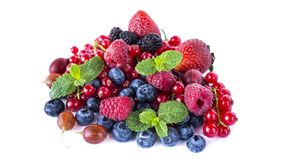 Fruits and berries isolated on white background. Ripe red currants, raspberries, blueberries,  strawberries, gooseberrie, blackber. Ries with a mint leaf. Sweet Stock Photography