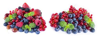 Fruits and berries isolated on white background. Ripe red currants, raspberries, blueberries,  strawberries, gooseberrie, blackber. Ries with a mint leaf. Sweet Royalty Free Stock Images