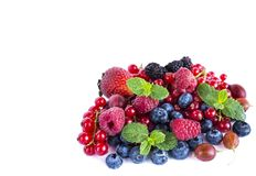 Fruits and berries isolated on white background. Ripe red currants, raspberries, blueberries,  strawberries, gooseberrie, blackber. Ries with a mint leaf. Sweet Stock Image