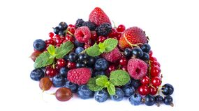 Fruits and berries isolated on white background. Ripe red currants, raspberries, blueberries,  strawberries, gooseberrie, blackber. Ries with a mint leaf. Sweet Royalty Free Stock Photos