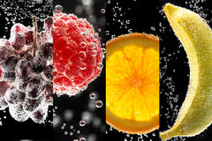Fruits and berries (photo collage) into the glass with sparkling Stock Photos