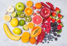 Fruit and berries rainbow colors. stock photos