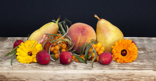 Fruits and berries. On a rough board Royalty Free Stock Photo