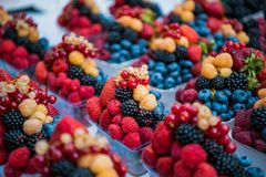 Fruits, berries and vegetables on the counter at the street market. Royalty Free Stock Image