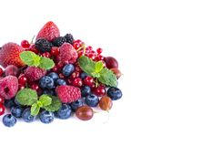 Fruits and berries on white background. Ripe blueberries, raspberries, red currants, gooseberries, blackberries and strawberries. Sweet and juicy fruits with Stock Photography