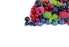Fruits and berries on white background. Ripe red currants, raspberries, blueberries,  strawberries. Sweet and juicy fruits with co. Ts and berries on white Royalty Free Stock Photos