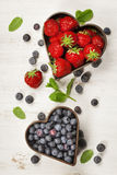 Fruits and berries on white marble background Royalty Free Stock Image