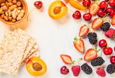 Fruits, berries and whole grain crisp bread on white marble table copy space.The concept of healthy eating. stock image