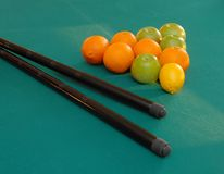 Fruits on billiards table stock images