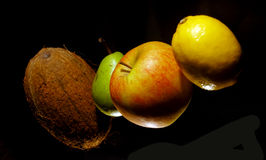 Fruits on black Stock Images